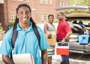 Boy heads off to college. Parents helping move him into dorms.